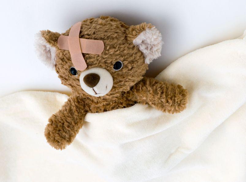 13693503 – teddy bear ill in bed